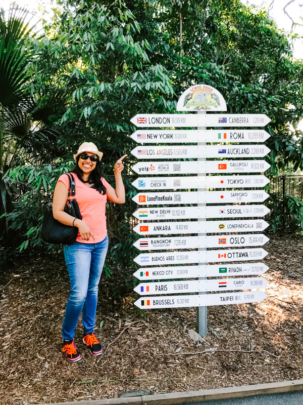 Aliya Bora at sign in front of Lone Pine Koala Sanctuary in Brisbane, Australia.