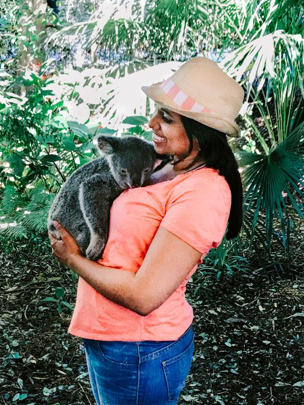 Aliya Bora with a baby Koala at Lone Pine Koala Sanctuary in Brisbane, Australia.