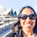 Aliya Bora standing in front of the Sydney Opera House in Australia